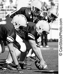 Football linemen getting ready
