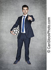 Football manager pointing at you