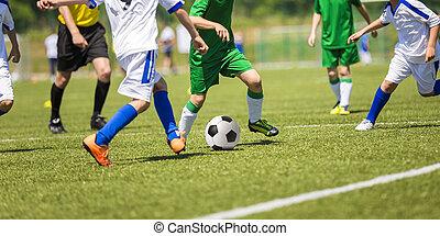 Football match - Young boys play football soccer match....