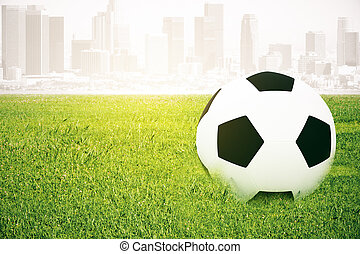 Football on abstract city background