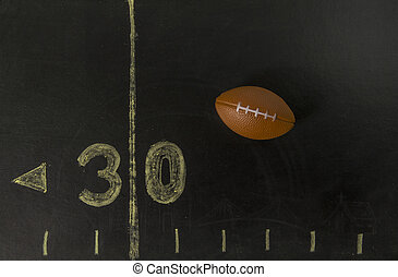 Football on the black field