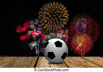 Football on the field with stadium and firework background