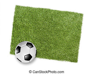 Football or soccer ball on a patch of green turf