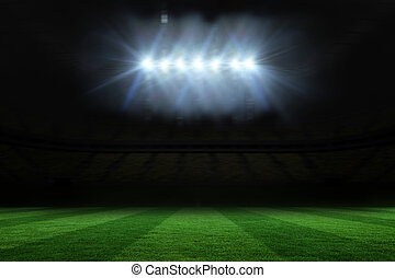 Football pitch under spotlights - Digitally generated ...