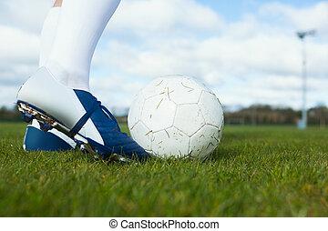 Football player about to kick ball