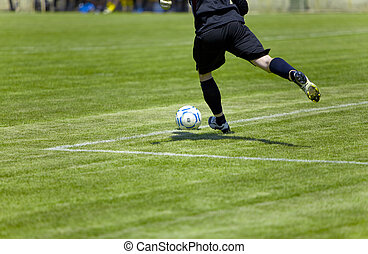 Football player beats on ball