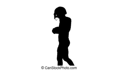 Football player carries the ball in his hand. Slow motion.