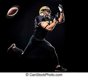Football player catching ball