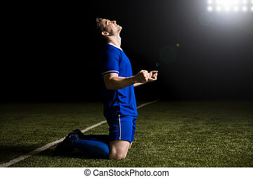 Football player cheering after scoring