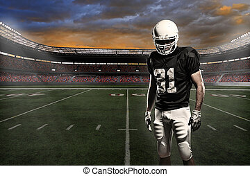 Football Player - Football player with a black uniform, in a...