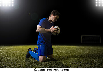 Football player happy after scoring goal