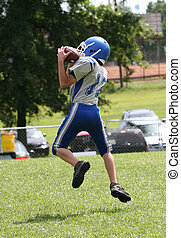 Football Player in Air - Football player in air catching...
