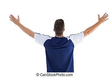 Football player in blue celebrating a victory on white ...