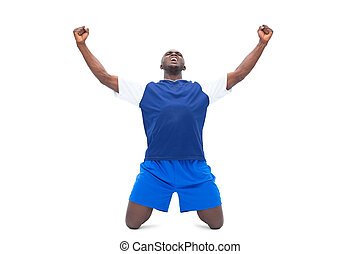 Football player in blue celebrating a win on white...