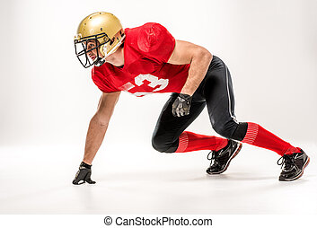 Football player in protective sportswear