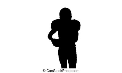 Football player in sports gear runs with the ball. Silhouette. Slow motion