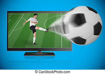 Football player in white kicking ball out of tv against blue background with vignette