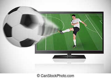 Football player in white kicking ball out of tv against white background with vignette
