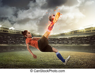 Football player kick fire ball on the stadium