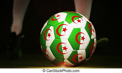 Football player kicking algeria flag ball on black...