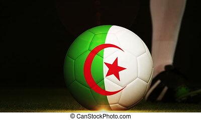 Football player kicking Algeria flag ball - Football player...