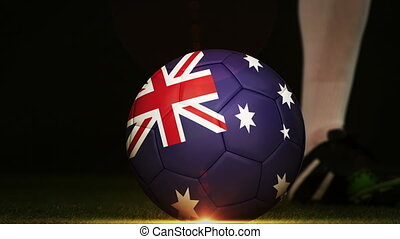 Football player kicking Australia flag ball - Football...