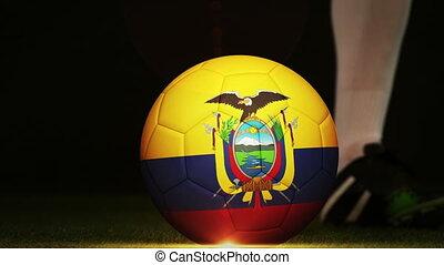 Football player kicking Ecuador flag ball - Football player...