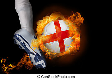 Football player kicking flaming england ball