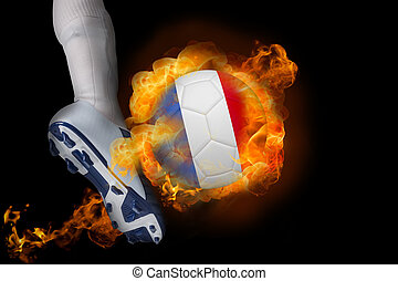 Football player kicking flaming france ball