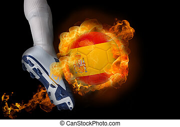 Football player kicking flaming spain ball