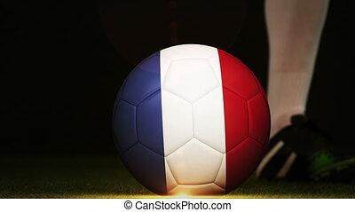 Football player kicking France flag ball - Football player...