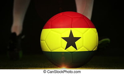 Football player kicking ghana flag