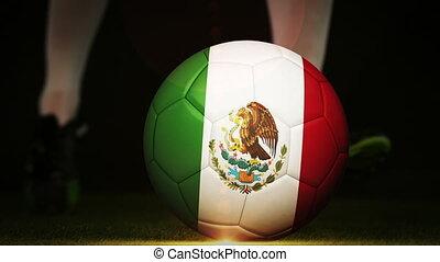 Football player kicking mexico flag