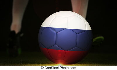 Football player kicking russia flag