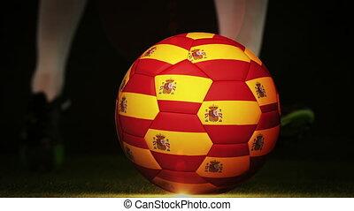 Football player kicking spain flag