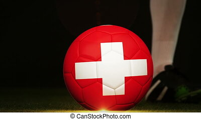 Football player kicking switzerland