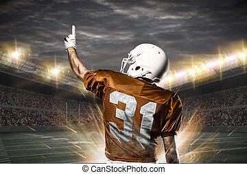 Football Player on a orange uniform celebrating on a...