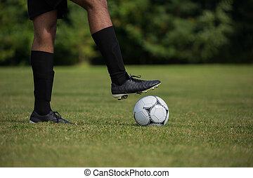 Football player ready to kick the soccer ball