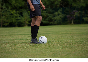 Football player ready to kick the soccer ball