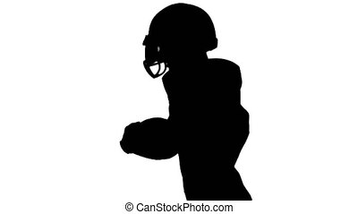 Football player running with the ball and sports equipment. Silhouette