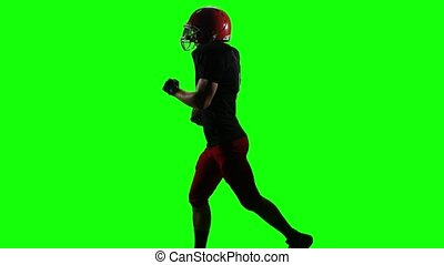 Football player running with the ball for the winning player. Green screen