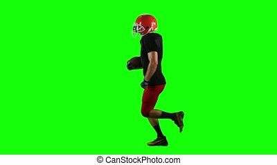 Football player running with the ball in his helmet. Green screen