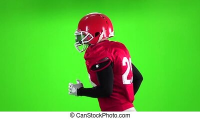 Football player running with the ball. Slow motion. Close up. Green screen