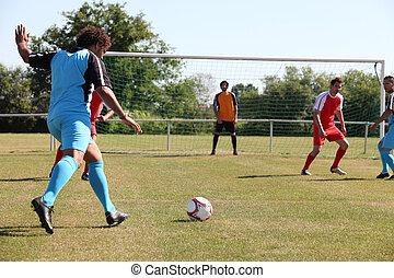 Football player shooting a goal