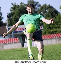 football player shots the ball