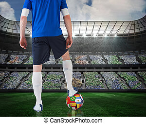 Football player standing with flag