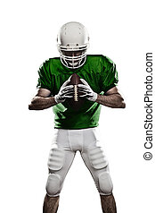 Football Player with a green uniform and a ball in the hand...