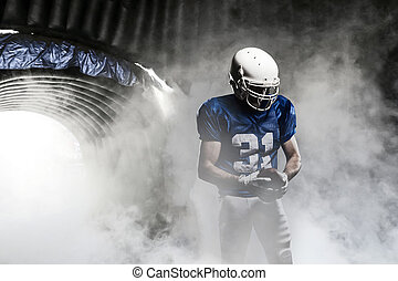 Football Player - Football player, leaving a smoky tunnel,...
