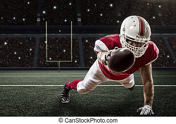 Football Player with a red uniform scoring on a Stadium.