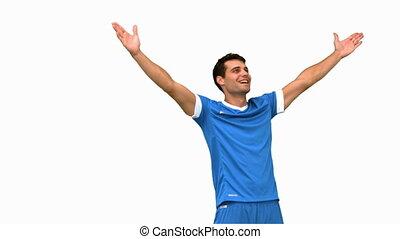Football player waving a kissing at